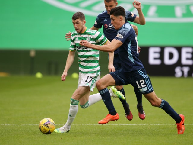 Ryan Christie of Celtic in action at the Scottish Premiership with Shaun Want of Hamilton Academical on August 3, 2020