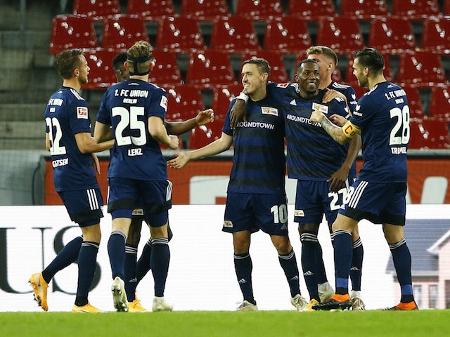 Union Berlin's Max Kruse celebrates his second goal with teammates on November 22, 2020