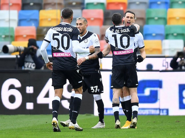 Kevin Lasagna of Udinese celebrates his first goal with teammates on January 10, 2021