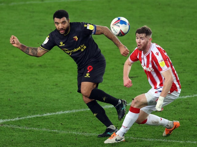 Troy Deeney of Watford in action with Nathan Collins of Stoke City in the championship on January 22, 2021