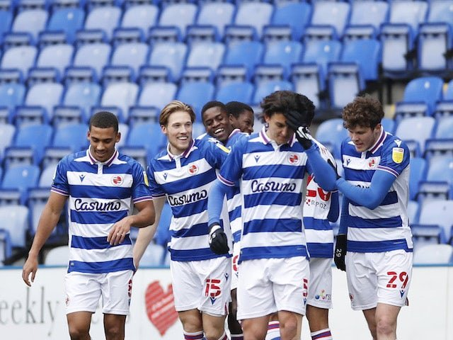 Reading's Alfa Semedo celebrates with teammates after scoring his first goal on February 13, 2021