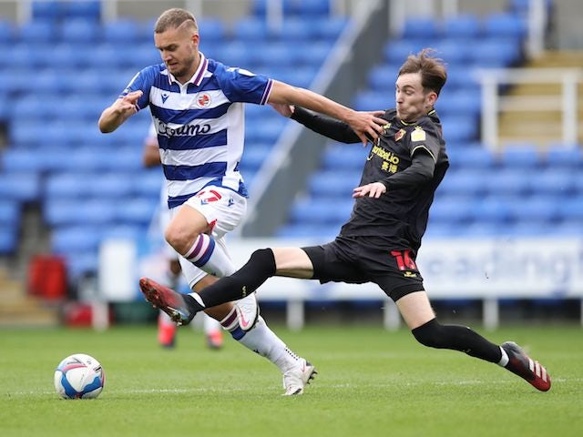 George Puscas of Reading in action with James Garner of Watford in the championship on October 3, 2020